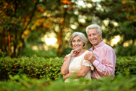 portrait of beautiful caucasian senior couple in the park