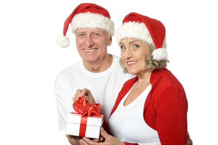 Happy beautiful elderly couple celebrating new year on white background
