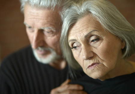 lamentable: Close-up portrait of thoughtful senior couple at home Stock Photo