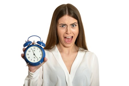 Young beautiful woman with the clock against white background