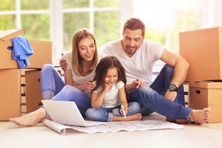 Young happy family moving into their new home Stock Photo