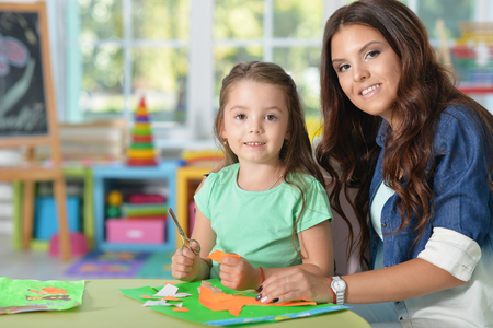 teaches: Mother teaches her cute little daughter to do craft items