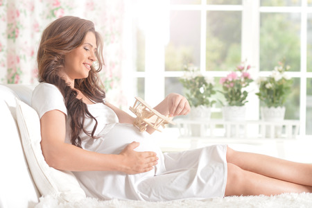 Portrait of Happy smiling pregnant woman  in chair