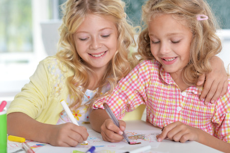 Portrait of a two beautiful little girls at class Stock Photo