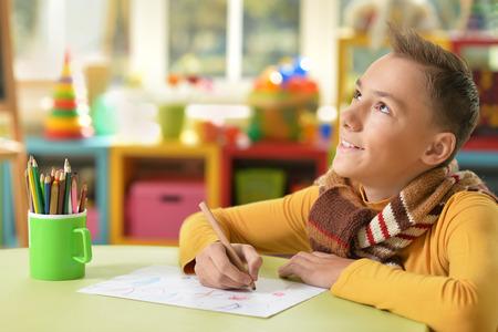 boyhood: Portrait of teen boy drawing a picture