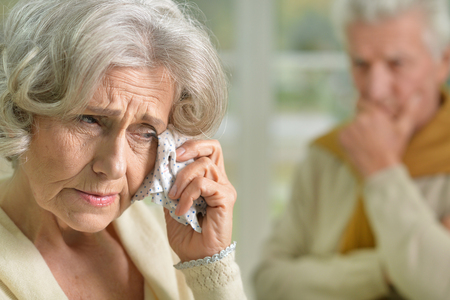 amiable: Portrait of upset senior woman holding handkerchief
