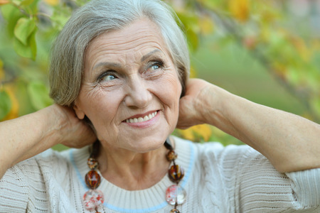 Portrait of a senior woman in summer park Stock Photo