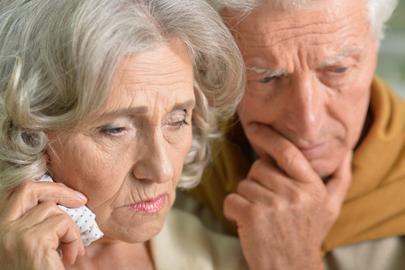 lamentable: Portrait of sad senior couple looking away