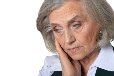 Portrait of tired senior woman isolated on white background Stock Photo