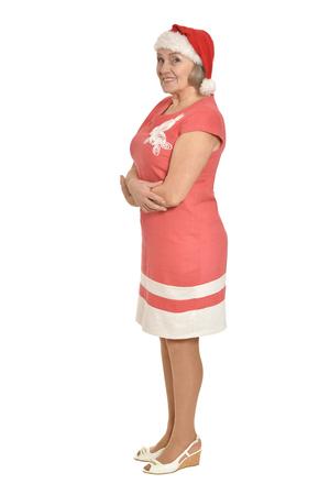 full lenght: Full lenght portrait of smiling senior woman in Santa hat isolated on white background