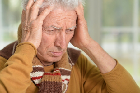 lamentable: Portrait of stressed senior man with hands on his head Stock Photo