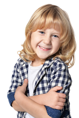 preadolescent: Portrait of happy little boy with long blond hair looking at  camera