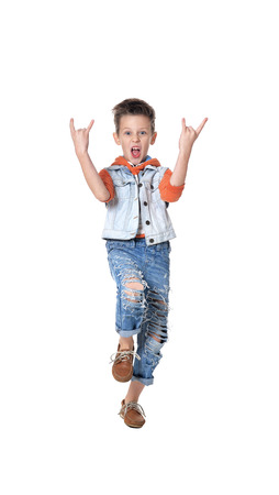 Full length portrait of happy  little boy showing rock gesture isolated on white background Stock Photo