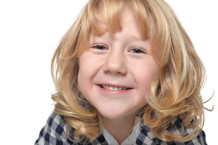 preadolescent: Portrait of happy little boy with long blond hair looking at camera Stock Photo