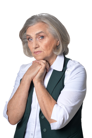 Portrait of serious senior woman looking at camera isolated on white background
