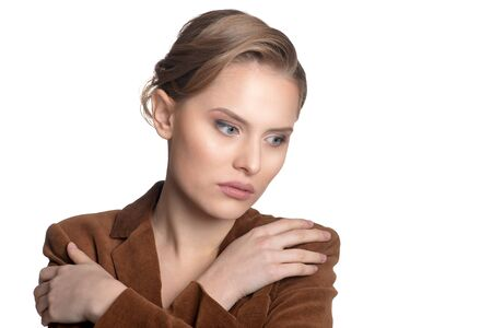 Portrait of sad young woman in brown jacket  looking away isolated on white background