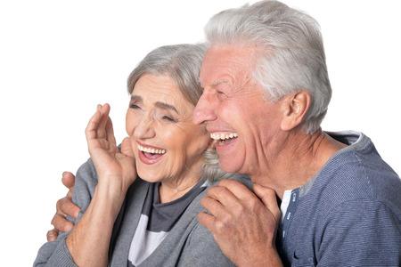 Portrait of laughing senior couple isolated on white background