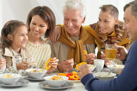 grand sons: Portrait of a big happy family have breakfast todether