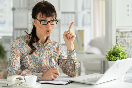 Portrait of young exited woman with laptop Stock Photo