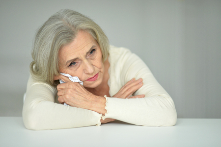 handkerchief: Portrait  of thoughtful senior woman with handkerchief