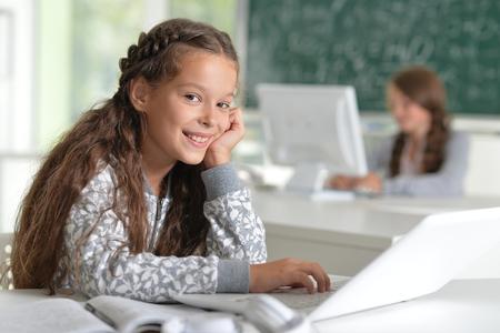 tweens: Portrait of a beautiful little girls at class