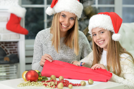 tenager: Portrait of two happy sisters preparing for Christmas at home Stock Photo