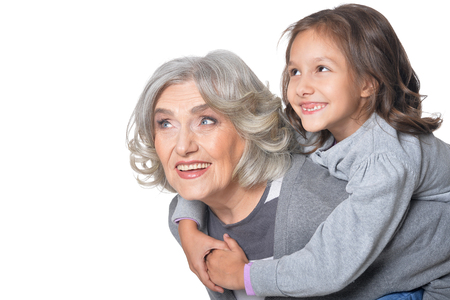Portrait of happy grandmother and granddaughter, woman showing thumb up  isolated on white background