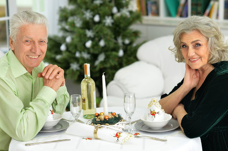 new age: Portrait of happy senior couple have a Christmas dinner at home Stock Photo