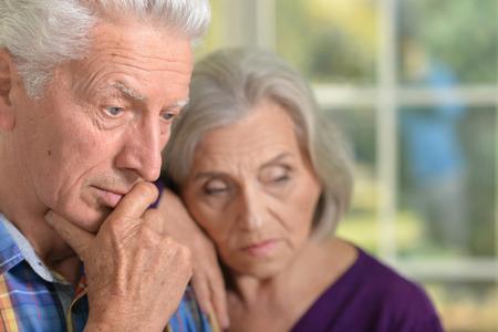 lamentable: Portrait of a cute thoughtful senior couple