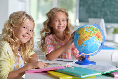 tweens: Portrait of two beautiful little girls at class