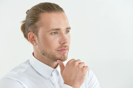 young hipster businessman posing against white background