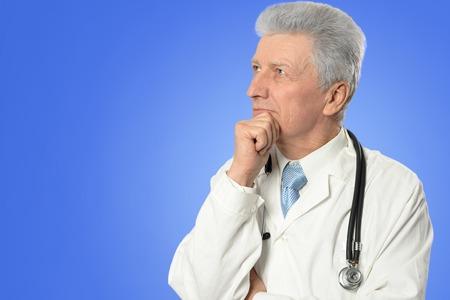 white robe: Portrait of a mature male doctor in white robe