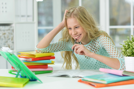 teenager girl doing homework at her room