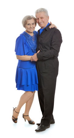 mature couple dancing on a white background