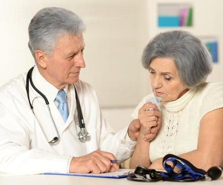 doctor examine: Portrait of a doctor examine patient, senior woman