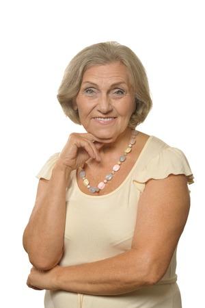 Portrait of a beautiful senior woman posing against white