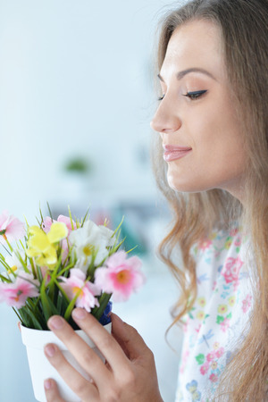 personable: beautiful young woman with flowers