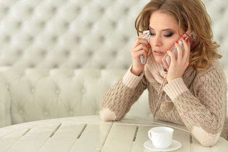 Crying woman with phone