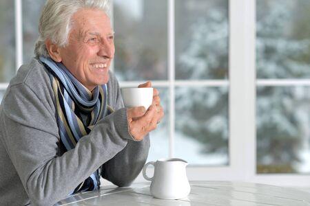 mature man drinking coffee Stock Photo