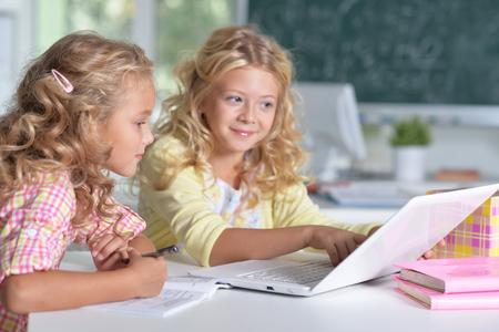 tweens: beautiful little girls at class Stock Photo