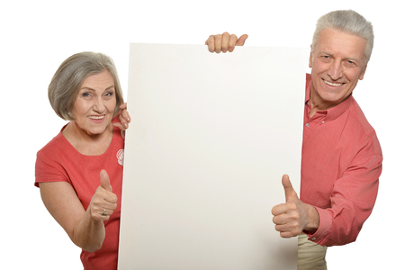 mature couple with empty paper
