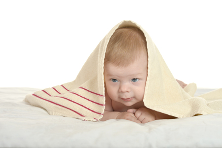 Adorable baby boy  under  blanket Stock Photo