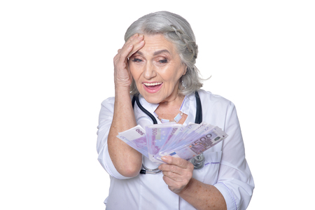 doctor money: mature female doctor with money Stock Photo