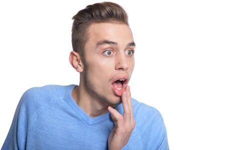 facial expression: young man making facial expression Stock Photo