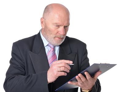 against white: mature businessman posing against white