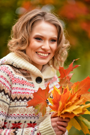 personable: blonde woman with autumn leaves