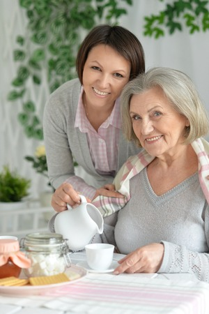 mother and daughter drinking tea Stock Photo