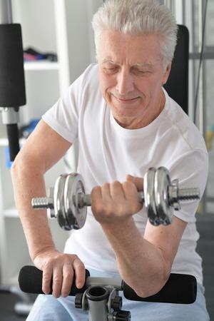 mature man doing exercises Stock Photo
