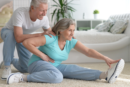 mature couple making exercises