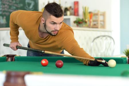 young man playing billiard